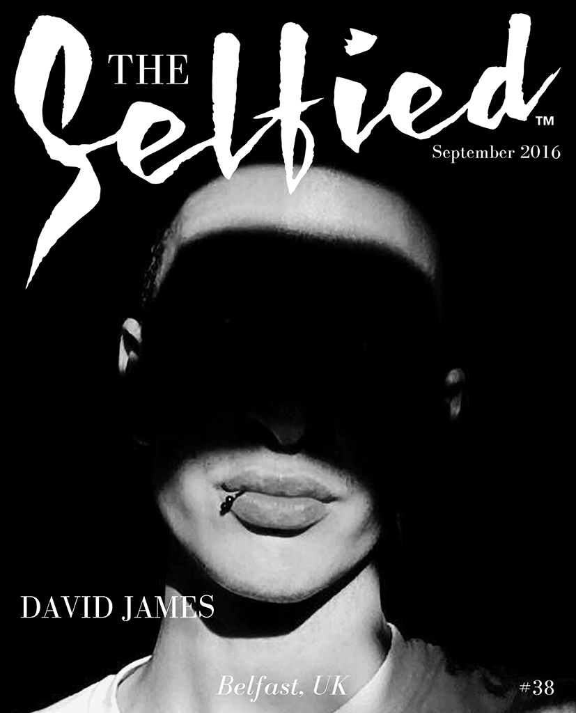 a black and white selfie by David James with shadow across face