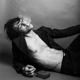 A photo of a man reclining smoking a cigarette, by veronica orlova