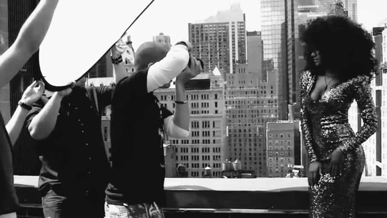 Photographer Manny Roman during a New York rooftop fashion shoot.