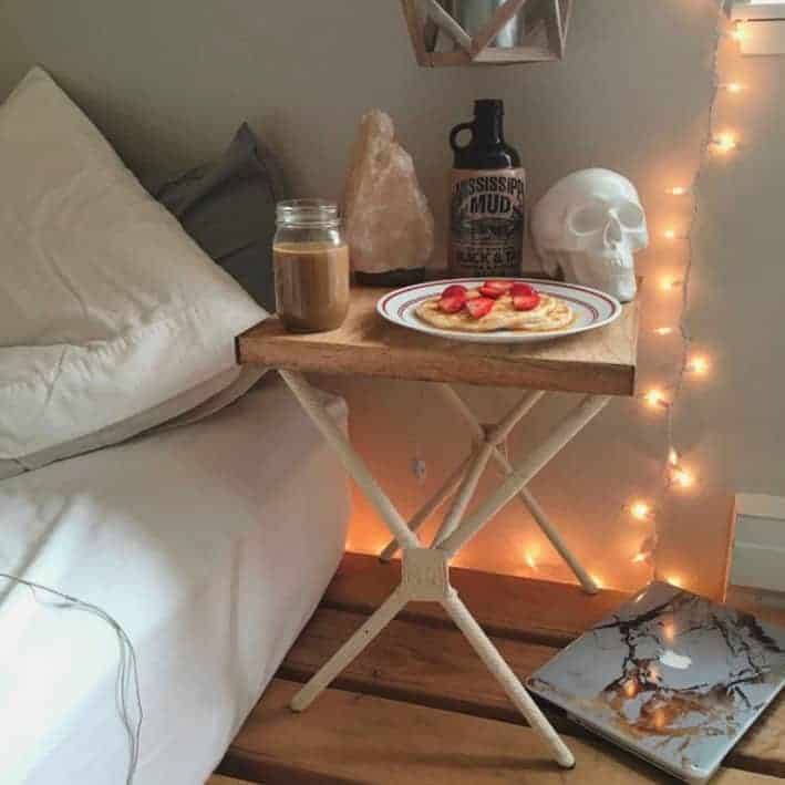 room still life with fairy lights and skull