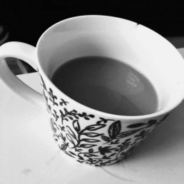 A black and white photo of a cup of tea