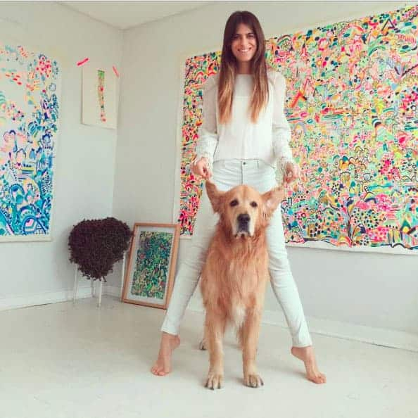 Artist Ana Bonamico with her dog and her paintings