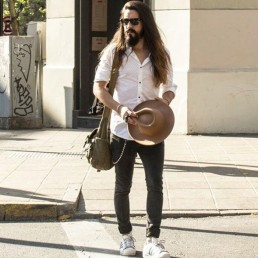 Sebastian Sotomillar, Entrepreneur, Creative director and model, walking in the street