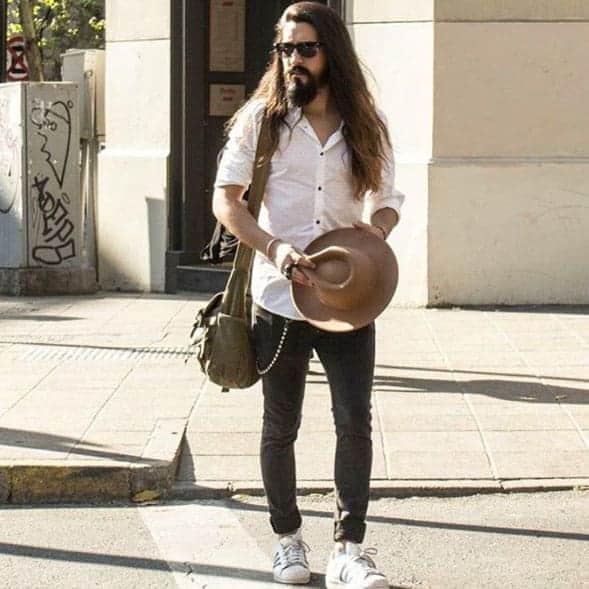 Sebastian Sotomillar, Entrepreneur, Creative director and model, walking in the street