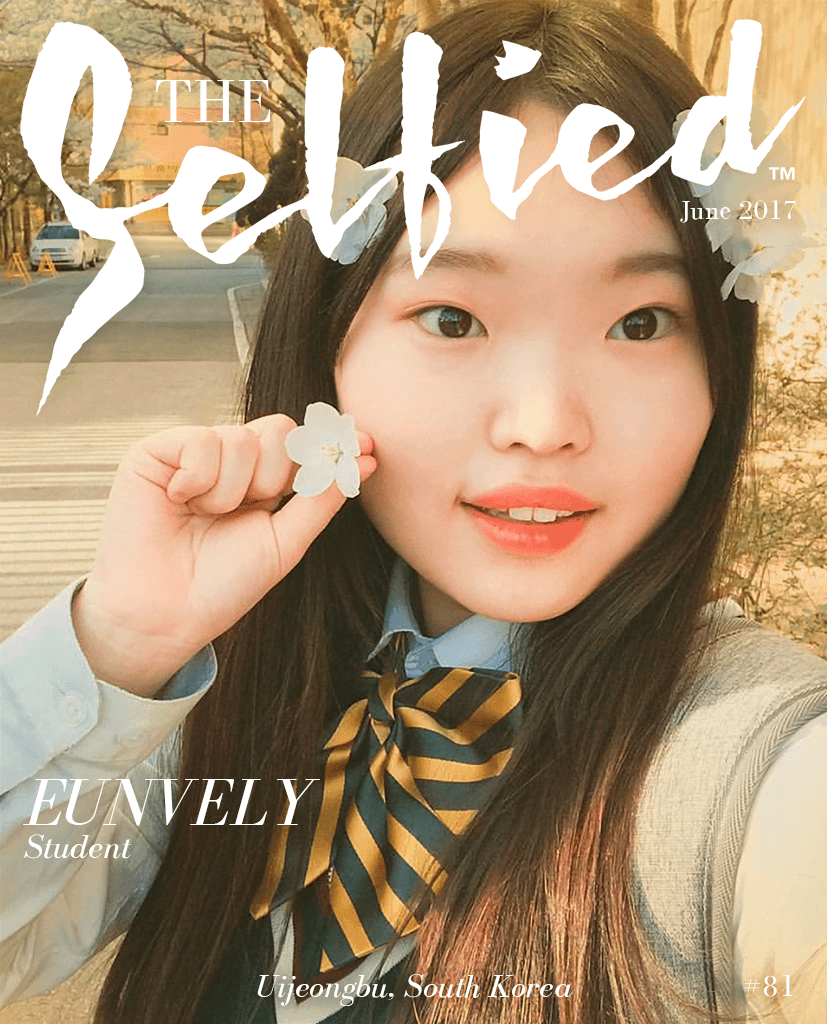 A selfie pic of Eunvely during cherry blossom season, on the cover of The selfied magazine